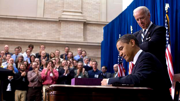 President Obama signs the American Recovery and Reinvestment Act as Vice President Biden watches in Denver, Colo. on Feb. 17, 2009 (White House photo by Pete Souza).